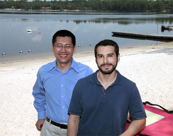 Associate professor Ming Ye and graduate student Fernando Rios