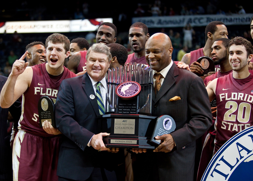 ACC Commissioner John Swafford presents the championship trophy to Coach Leonard Hamilton and the FSU men's basketball team. (All photos by Ross Obley/Seminoles.com)