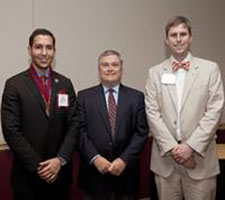 "Florida State President Eric J. Barron, center, recently welcomed student Aviram ""Avi"" Assidon, left, into the Garnet and Gold Scholar Society. Assidon served as SGA president and a member of the university's Board of Trustees for 2011-2012. At right is James Hunt, an adviser to the Garnet and Gold Scholar Society in the Division of Student Affairs."