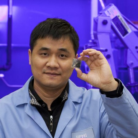 "Changchun ""Chad"" Zeng displays a sample of buckypaper."