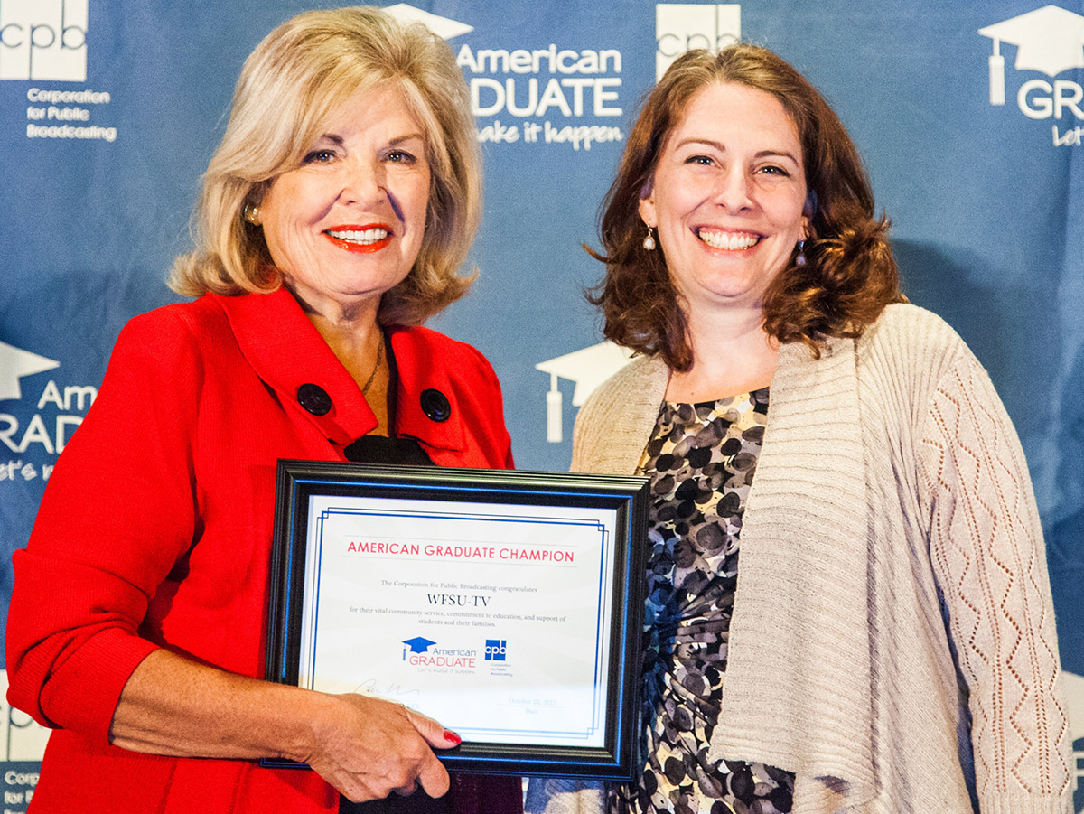 Corporation for Public Broadcasting president and CEO Patricia Harrison, left, presents the American Graduate Champion award to WFSU's Suzanne Smith at the National Educational Telecommunications Association conference in October.