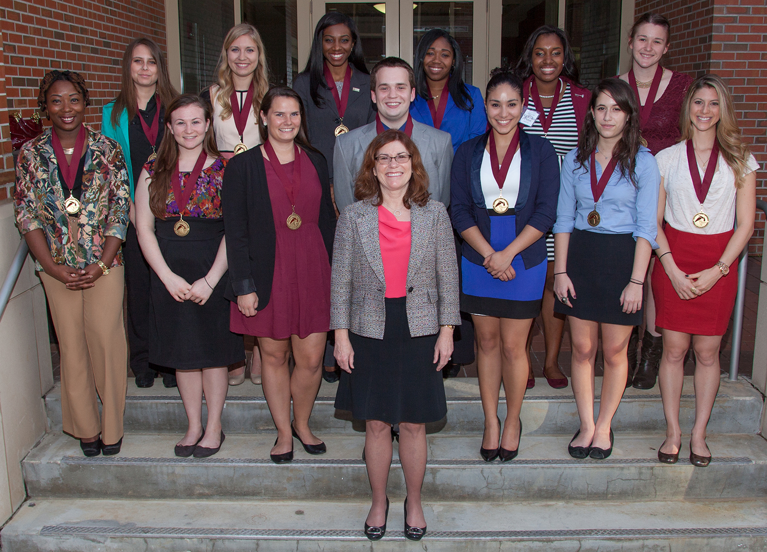 FSU's Executive Vice President for Academic Affairs Garnett S. Stokes stands front and center with the new members of the Garnet and Gold Scholar Society.