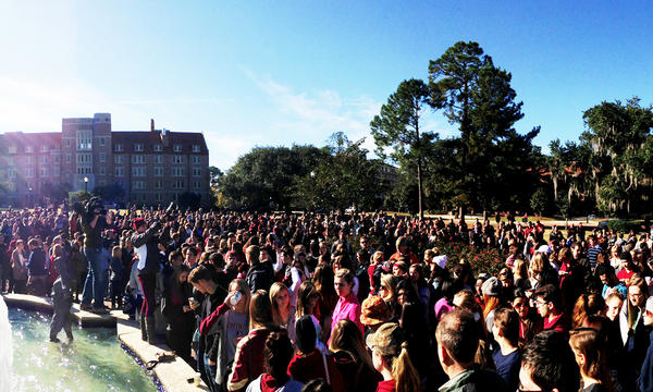 Students gathered in prayer Thursday morning at Landis Green following the incident at Strozier Library.