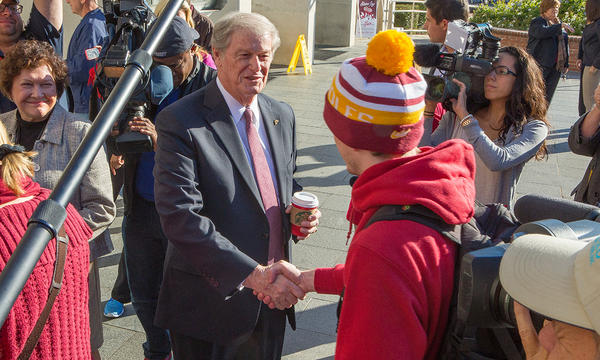 President Thrasher greets students at Strozier Library Friday morning.