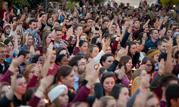 Students do the war chant at the Gathering of Unity Thursday night.