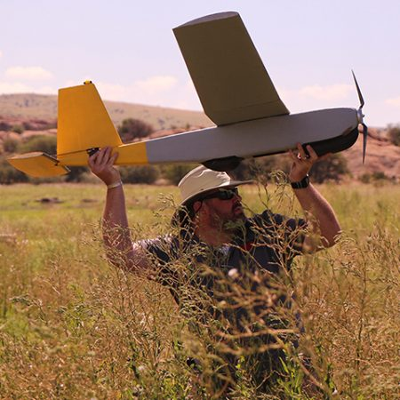 David Merrick prepares to launch the fixed-wing drone named Oscar.