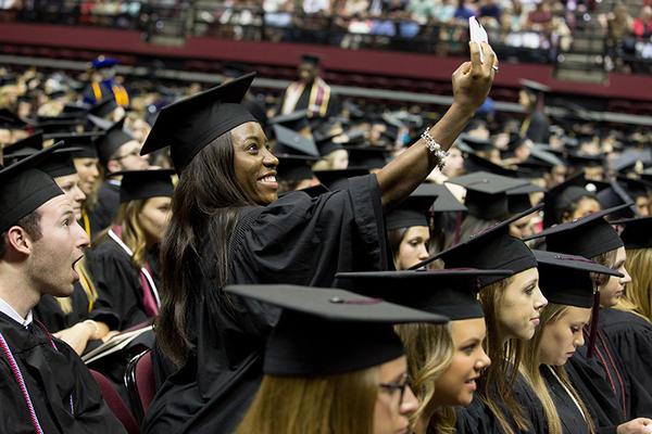 Graduates'say cheese' at FSU spring commencement. (FSU Photography/Bill Lax)