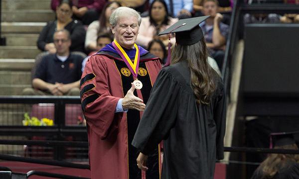 President John Thrasher congratulates graduates at Florida State's 2015 spring commencement. (FSU Photography/Bill Lax)