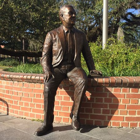 a statue of former FSU President Robert Manning Strozier on the steps of Strozier Library