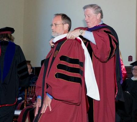 President Thrasher hoods Christopher Still with an Honorary Doctor of Humane Letters from Florida State University.