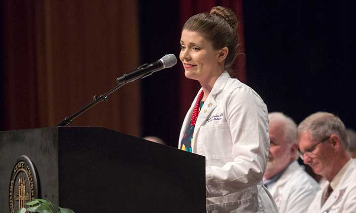 Dr. Rachel Bixler, a family practitioner and alumnus, addresses FSU's 121 new medical students Friday, Aug. 12.