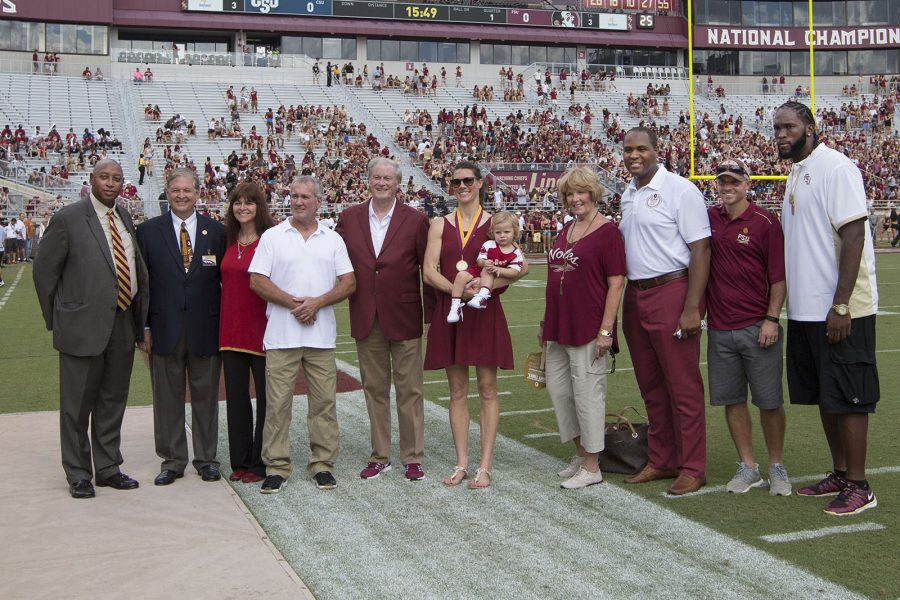 The newest FSU Athletics Hall of Fame class is recognized on the field. Stan Wilcox, Charlie Barnes (Moore-Stone Award winner), Sally Summer Rozanski, Daniel Robinson (father of Shane Robinson), John Thrasher, Lacy Janson Harper and son Janson, Vicki Stock (wife of Ernie Stock), Garrett Johnson, Matt Cloer and Alex Barron.