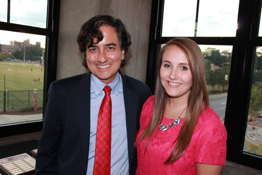 Distinguished Young Alumni Award winner Robyn Metcalf with Dean Clark.