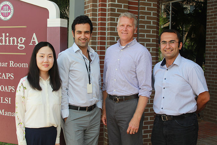 Assistant Professor of Communication Jinghui Hou , Assistant Professor of Electrical and Computer Engineering Reza Arghandeh, Michael Ohlsen and Assistant Professor of Civil and Environmental Engineering Eren Erman Ozguven.