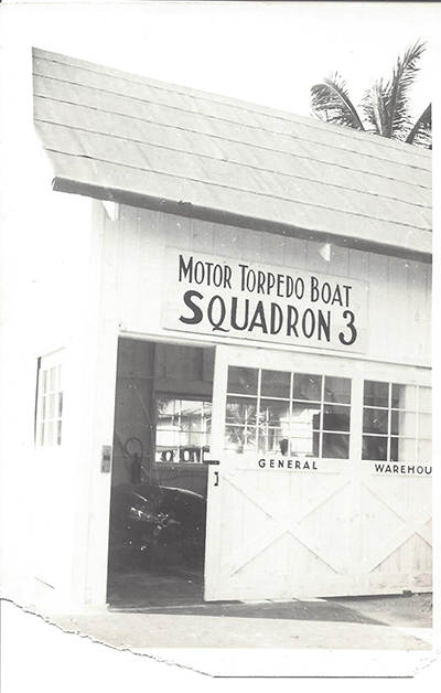 A complete undamaged Motor Torpedo Squadron 3 warehouse before or on December 10, 1941, prior to the Japanese aerial attack on that day. We can clearly see torpedoes stored inside this warehouse.