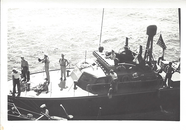 A PT-31 before or on December 10, 1941 as well. You can see the number 31 on the front hull. This boat was commanded by LTJG E. G. DeLong who is probably pictured in this image, but not sure. This boat was grounded and scuttled at Subic Bay, Luzon, January 20th, 1942 to prevent capture.