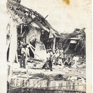 Depicts what we believe to be the day of the Japanese aerial bombing of Cavite Navy Yard on December 10, 1941. These images depict soldiers in helmets with rifles carrying a stretcher, with presumably an injured person. The helmets they wear are early war