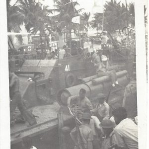 This image depicts PT-41 which was the flagship of Motor Torpedo Squadron 3. You notice clearly marked number 41 on the side of the bridge, as well as the squadron number 3 flag raised above the bridge. This image was most certainly taken on December 10 or shortly thereafter. You can see the soldiers wearing helmets/rifles and hastily loading PT-41. It even looks like the man in the right lower foreground has a camera! This exact boat carried General Douglas MacArthur and his family to safety from Corregidor to Mindanao on March 12, 1942, thus enabling MacArthur to escape and to make his famous