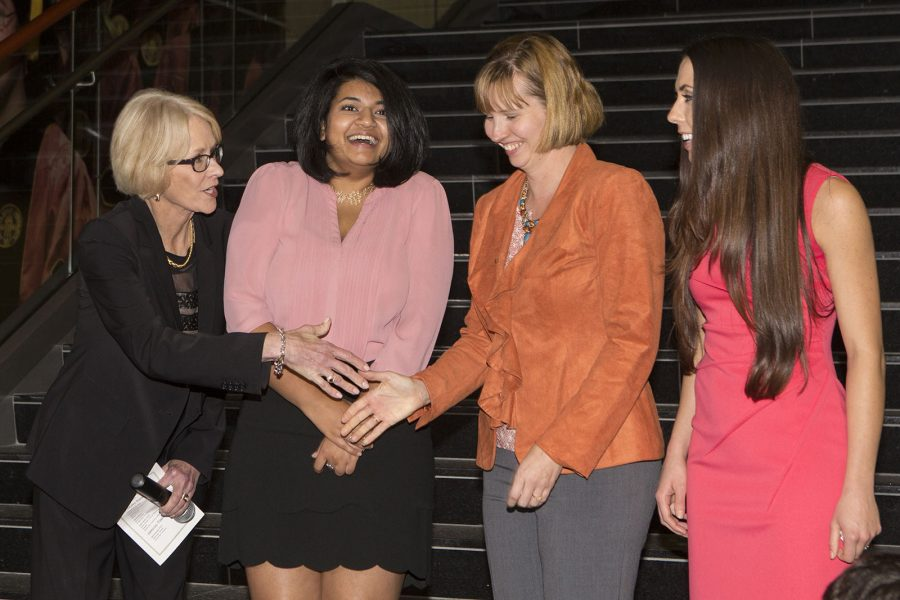 3 Minute Thesis Finalist Competition Dr. Judy Devine congratulates, from left, Madhuparna Roy (winner), Shaleen Miller (runner-up) and Tania Reynolds (people's choice).