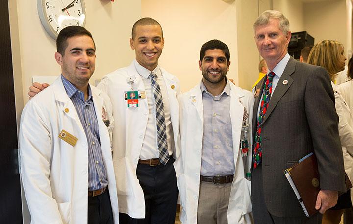 Third-year FSU medical students Gustavo Rey, Arnold Abud, Shawn Hassani with College of Medicine Dean John Fogarty at Orlando Health Friday, Dec. 9.