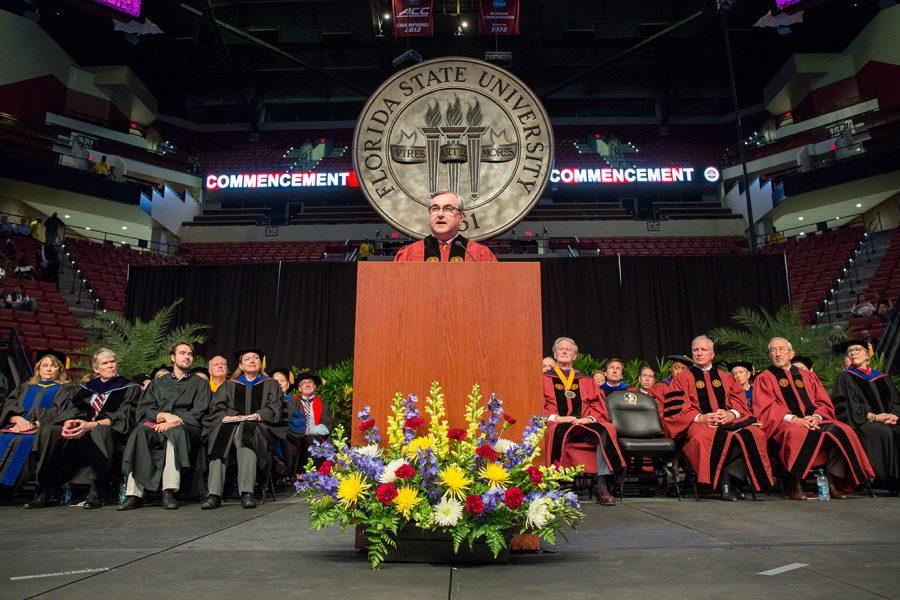 Saturday morning speaker Bob Sasser, chief executive officer of Dollar Tree, Inc., addresses graduates.