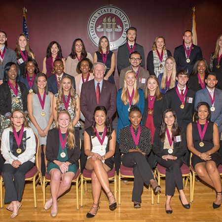President John Thrasher and the new inductees of the Garnet and Gold Scholar Society.
