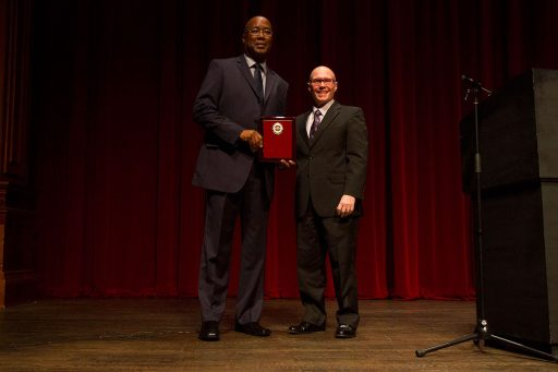 Darryl Marshall, assistant vice president of financial aid, receives the 2017 Dr. Martin Luther King Jr. Award from past recipient Bruce Lamont at the 29th Annual MLK Celebration Tuesday, Jan. 17. Photo credit: Lauren Alsina