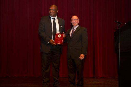 Okenwa Okoli, professor of engineering at the FAMU-FSU College of Engineering, receives the 2017 Dr. Martin Luther King Jr. Award from past recipient Bruce Lamont at the 29th Annual MLK Celebration Tuesday, Jan. 17. Photo credit: Lauren Alsina