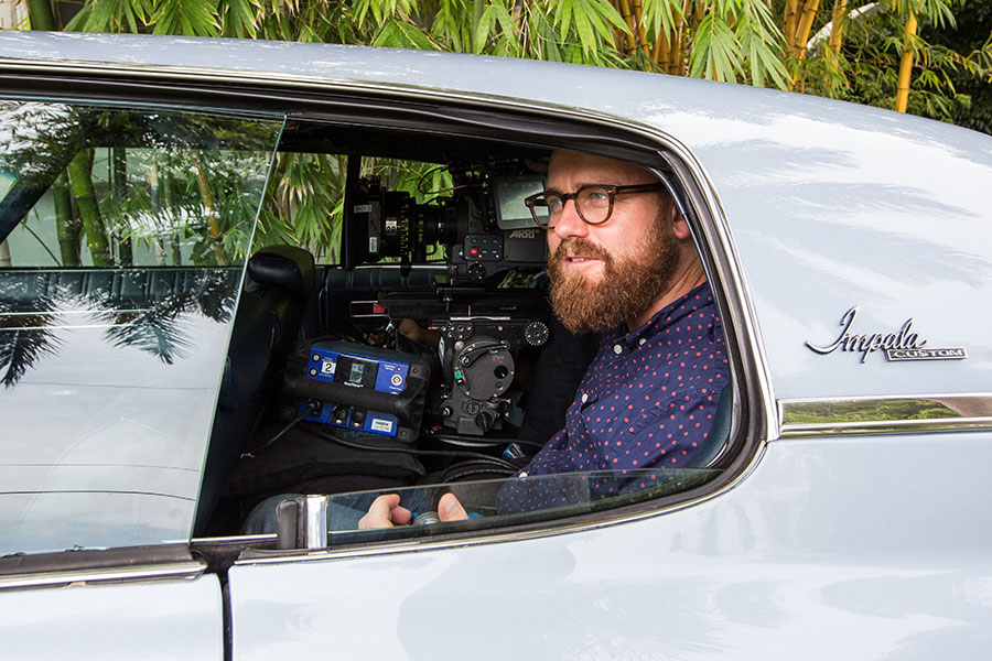 "Cinematographer James Laxton squeezes his camera gear into the backseat of a vintage Chevy Impala to film scenes for the Oscar-nominated film ""Moonlight."" Laxton is up for an Oscar in cinematography for his work on the film."