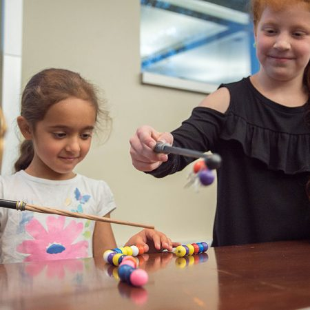 "At this year's movie-themed MagLab Open House, visitors can use Potteresque ""magnet wands"" to explore how magnets work. Photo credit: Stephen Bilenky/National MagLab."