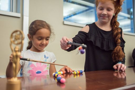 """At this year's movie-themed MagLab Open House, visitors can use Potteresque """"magnet wands"""" to explore how magnets work. Photo credit: Stephen Bilenky/National MagLab."""