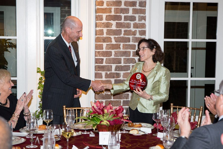 FSU Vice President for Research Gary K. Ostrander commemorates NSF Director France Córdova's visit at a dinner March 6, 2017.