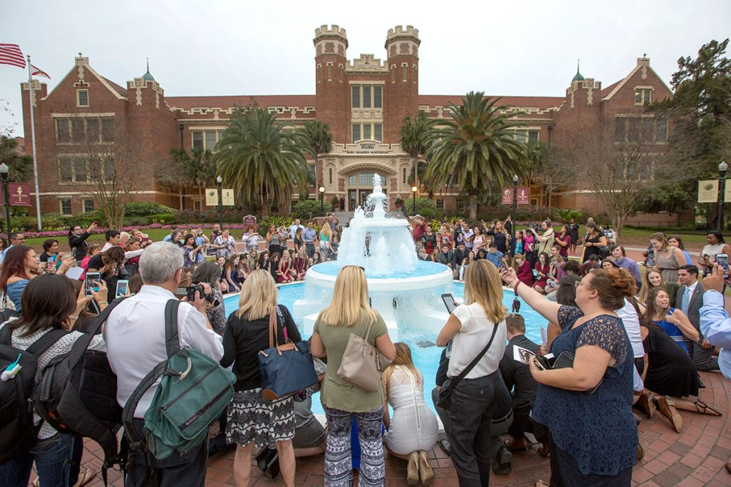Graduates, parents and friends gather for the tradition of ring dipping at the Westcott Fountain at the 2017 FSU Ring Ceremony Thursday, March 30.