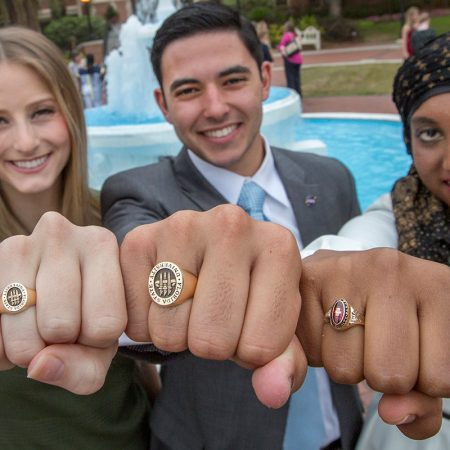 Soon-to-be FSU graduates Valerie Shallow, Nathan Molina and Inam Sakinah show off their new class rings during the 2017 FSU Ring Ceremony Thursday, March 30.