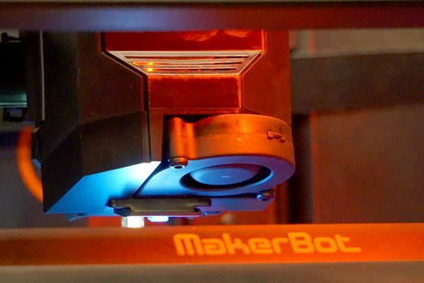 A state-of-the-art 3D printer methodically moves back and forth as it completes its project at DIGITECH 2017.