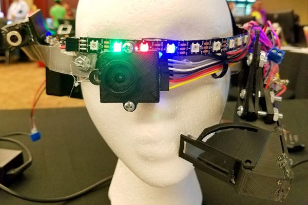 Ryan Whitney's head-mounted wearable computer is equipped with a thermal camera that can see in the dark.