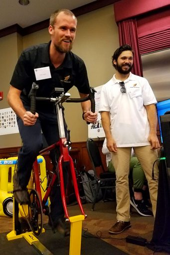 FSU doctoral student Erik Inglis tests out an ergometer on a stationary bike at DIGITECH 2017.