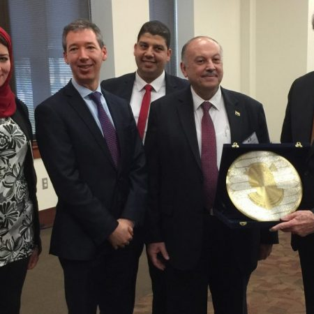President John Thrasher, at right, accepts a commemoration honoring FSU during a luncheon welcoming the Egyptian education administrators. From left: Dr. Nouran Abd El Hamid Ibrahim of Mansoura University; Anthony Koliha, director of the U.S. Department of State's Office of Global Educational Programs; Dr. Ibrahim Elbesoumy of Alexandria Technical Institute; and Professor Dr. Essam Khamis Alhanash, deputy minister of higher education and research, Arab Republic of Egypt.