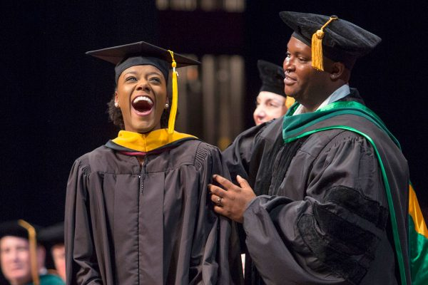 """The FSU College of Medicine celebrated the graduation of 117 new physicians and 11 master's students on Saturday, May 20. The Class of 2017 included a former campaign manager, a university trustee, a competitive swimmer, an English-Portuguese translator, an FSU cheerleader, a """"Midsummer Night's Dream"""" actor, a biofuel researcher, a deputy sheriff, a billiards champion and an All-American football player - Rhodes Scholar."""