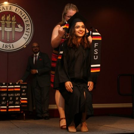 Graduate Rona Akbari receives a stole at the at the V-rak-ke-ce-tv Cultural Graduation Ceremony on May 4, 2017.