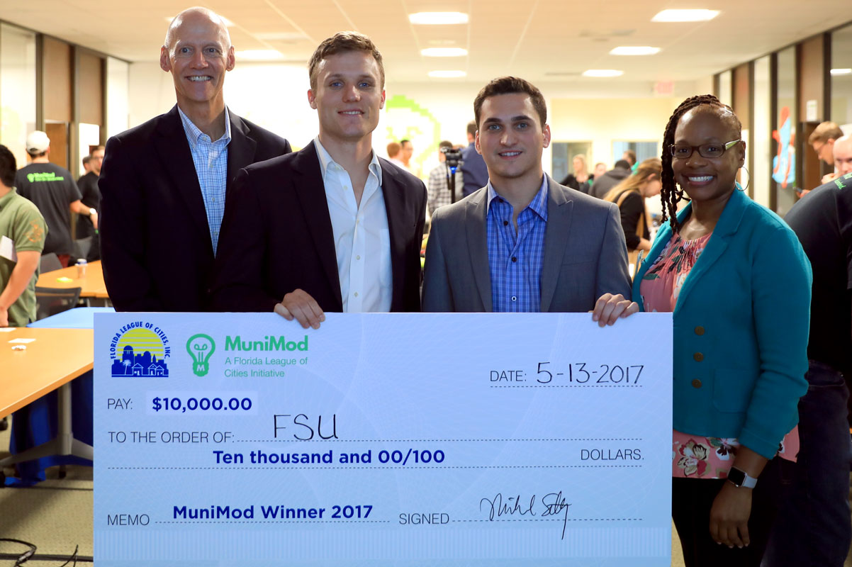 Tucker Russ and Maxwell Brecher won the MuniMod Hackathon competition hosted by the Florida League of Cities and business incubator Domi Station in Orlando.