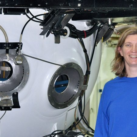 Associate Professor of Earth, Ocean and Atmospheric Science Amy Baco-Taylor next to a submersible in which she has conducted research.
