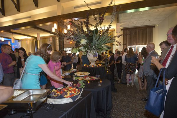 Patrons enjoy hors d'oeuvre before the announcement begins.