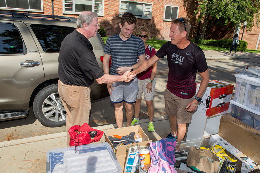 President Thrasher greets students and parents at residence halls move-in Aug. 23, 2017. (FSU Photography Services)
