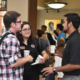 Center for Global Engagement International Graduate Ambassadors (iGAs) speaking to incoming international student. (Photo: Rebecca Mahony)