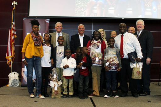 FSU Panama City Dean Randy Hanna, Chipola College President Sarah Clemmons and Gulf Coast State College President John Holdnak awarded each child of the Olds family with guaranteed scholarships Aug. 17 at FSU Panama City's Welcome Back Symposium.