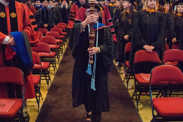 Of the 2,500 students graduating this summer, about 1,500 participated in the ceremony.