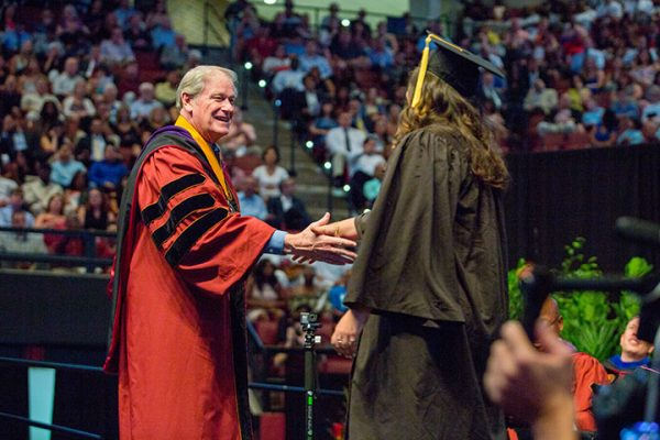 Summer commencement graduates were all smiles greeting President Thrasher as their names were announced.
