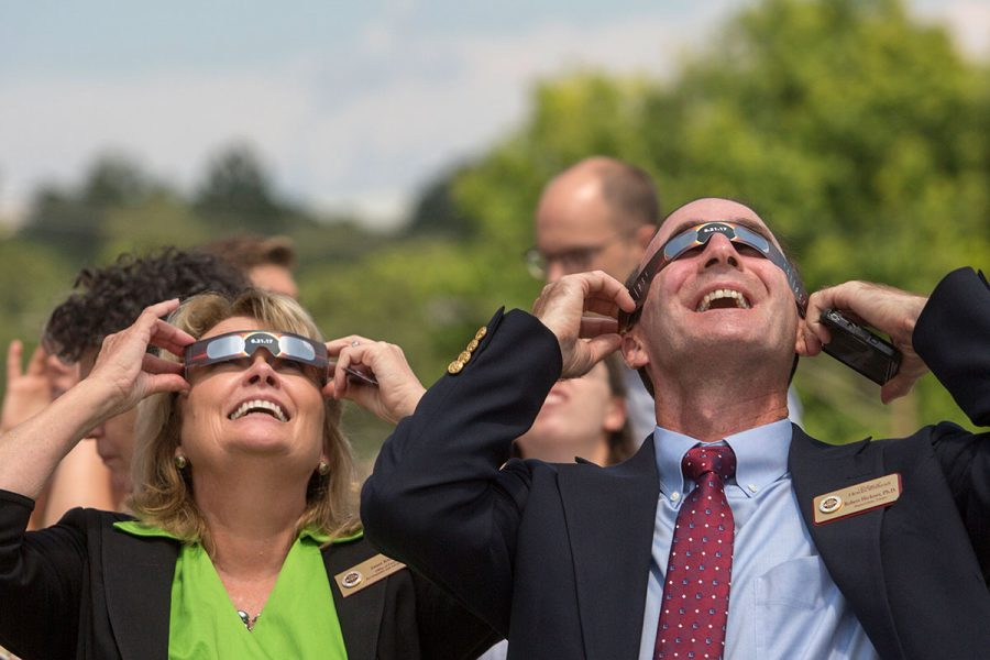 Faculty and staff check out the solar eclipse at New Faculty Orientation on Aug. 21, 2017. (FSU Photography Services)