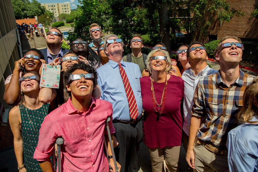 President and Mrs. Thrasher view the solar eclipse at the Union Green Aug. 21, 2017. (FSU Photography Services)